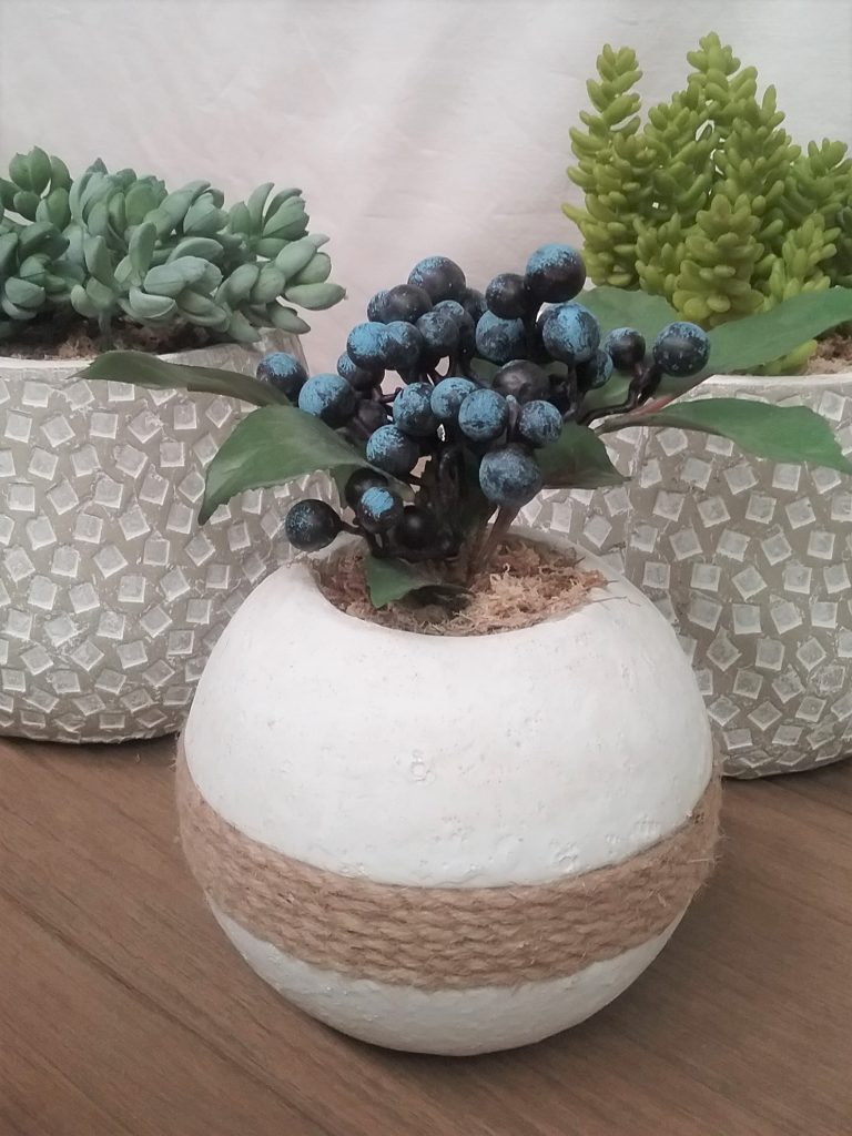 concrete sphere pot with rope and plant
